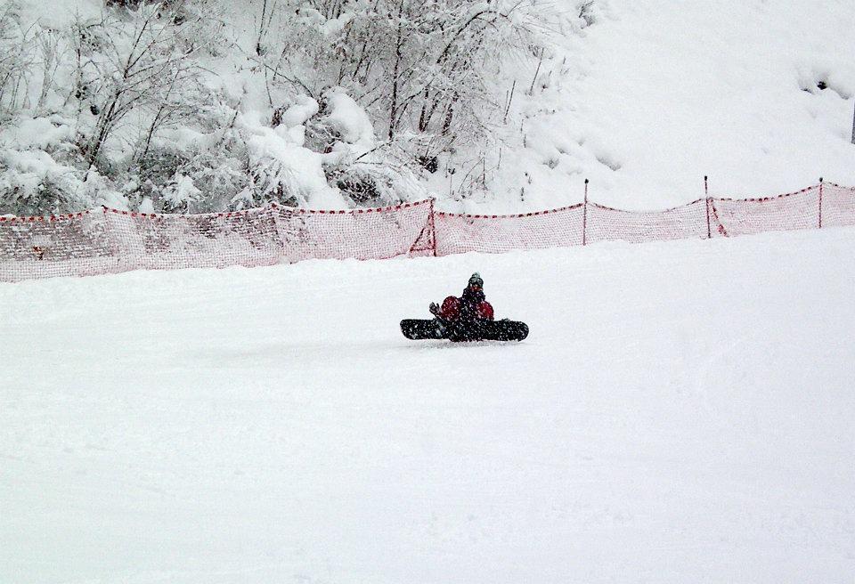 Snowboarder falls