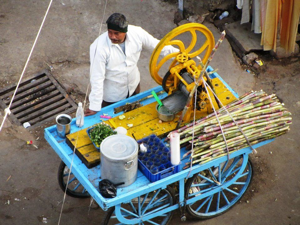 Sugar cane man waits for customers in Pushkar