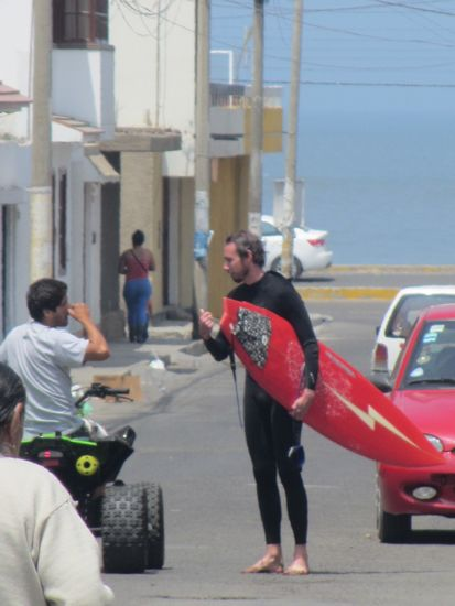 Surfing in Huanchaco, Peru