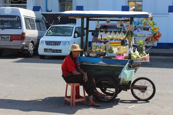 bored street cart seller Yangon