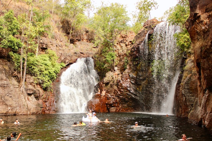 People swim in the Florence Falls plunge poole in Litchfield National Park