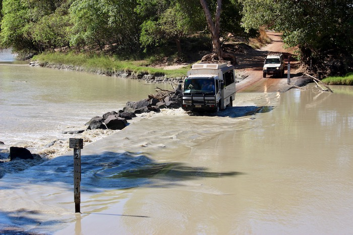 Daring to drive across Cahills Crossing at low-ish tide