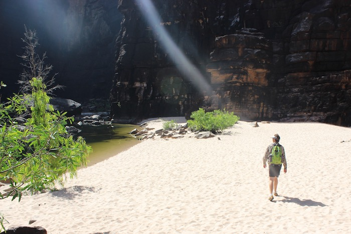 Walking the white sandy beach at Jim Jim Falls