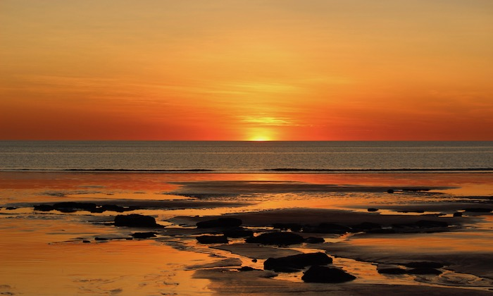 sun sets over water in Broome